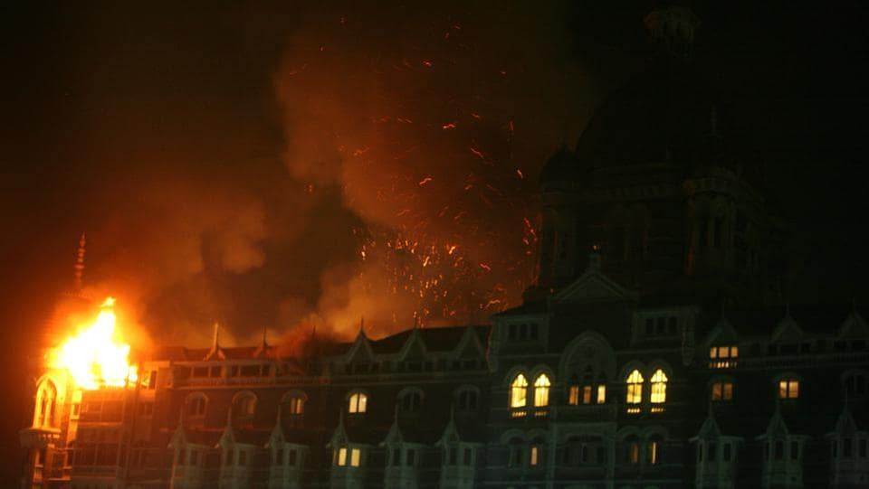 Mumbai's iconic Taj hotel during a grenade blast by the terrorist group in November 27, 2008.  The terrorists who reached India through the Arabian sea began the series of attacks at around 9:30 pm on November 26, 2008 at the Chhatrapati Shivaji rail station, one of the world's busiest, handling thousands of passengers everyday. (Hemant Padalkar / HT Photo)