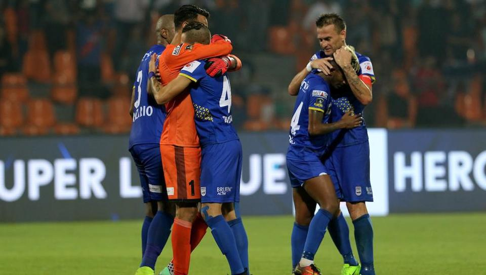 Mumbai City FC players celebrate after defeating FC Goa in an Indian Super League match.
