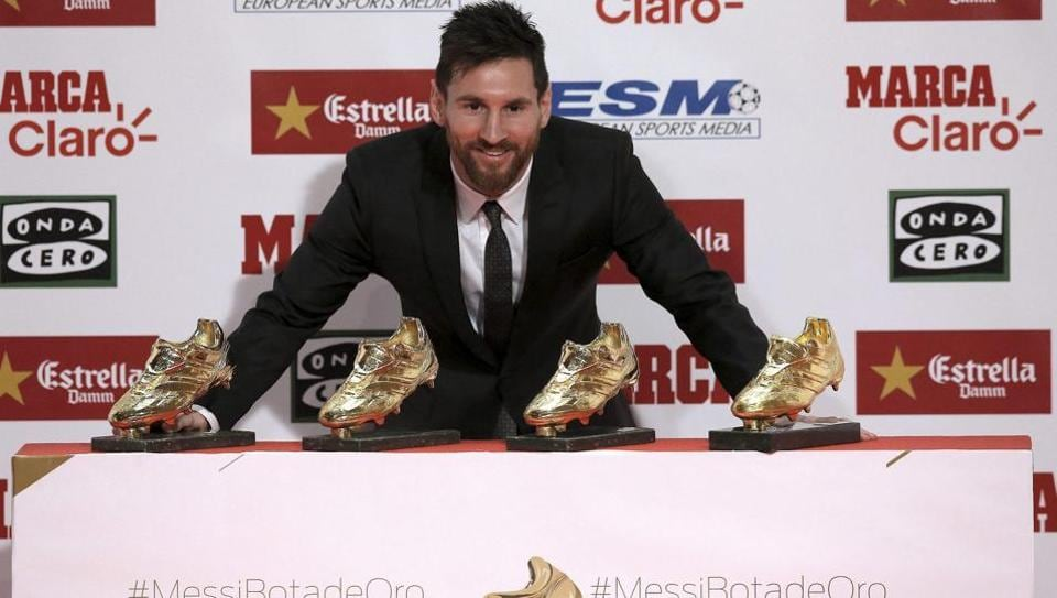 Lionel Messi poses with his fourth European Golden Shoe award.  (AP)