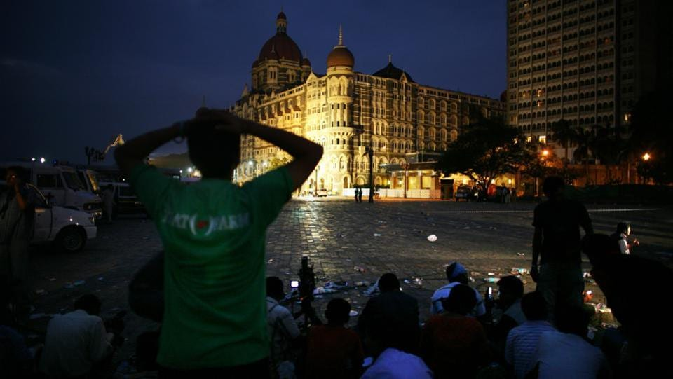 Members of the press wait outside the Taj Mahal Palace & Tower Hotel hotel during the siege in Mumbai. (Uriel Sinai / Getty Images)