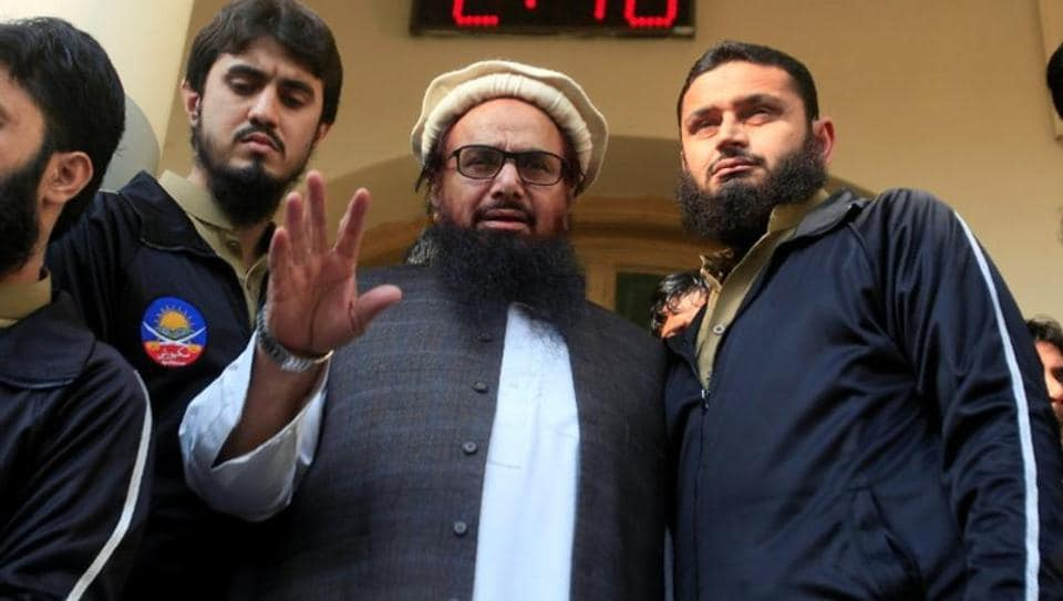 Hafiz Saeed speaks with supporters after attending Friday Prayers in Lahore  on November 24.