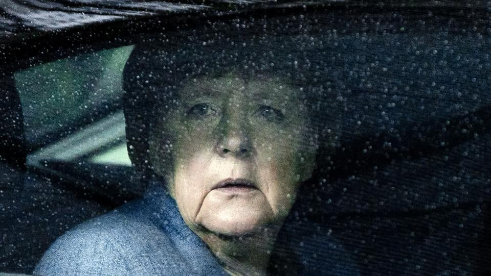 German Chancellor Angela Merkel looks through raindrops on her car window as she arrives for a summit at the European Council in Brussels on November 24, 2017. Leaders from the EU and six former Soviet states meet in Brussels on November 24 for the latest summit aimed at deepening ties. (Virginia Mayo / AFP)