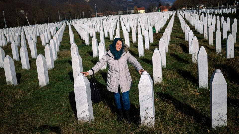 A woman mourns over a relative's grave at the memorial centre of Potocari near Srebrenica. United Nations judges on November 22, 2017 sentenced former Bosnian Serbian commander Ratko Mladic to life imprisonment after finding him guilty of genocide and war crimes in the brutal Balkans conflicts over two decades ago. (Dimitar Dilkoff / AFP)