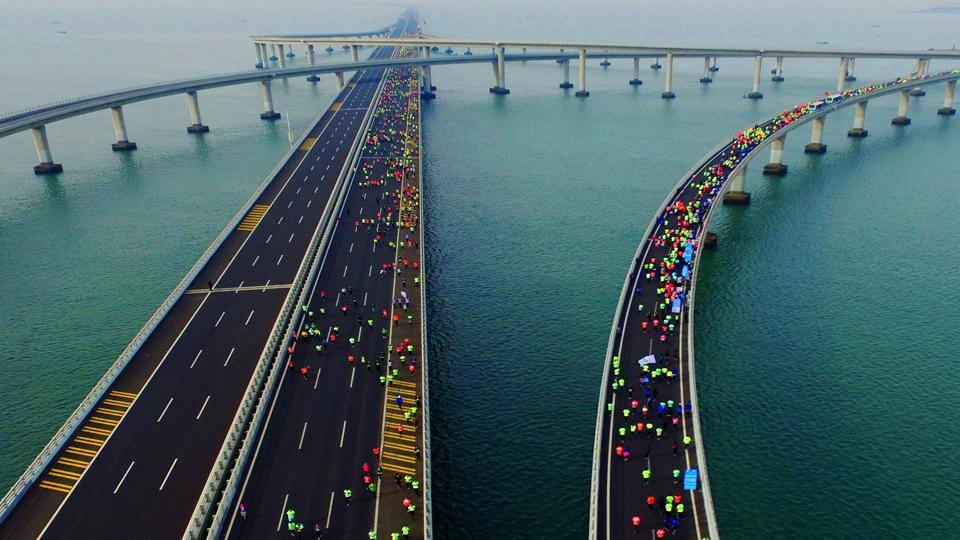 This photo taken on November 19, 2017 shows participants crossing the Jiaozhou Bay Bridge as they compete in the 2017 Qingdao International Marathon on the Sea in Qingdao in China's eastern Shandong province. (AFP)