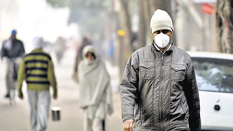 A man wears a pollution mask as he walks on a cold morning in  east Delhi. Despite the winter air pollution crisis being an annual affair, the state government seemed entirely unprepared for it