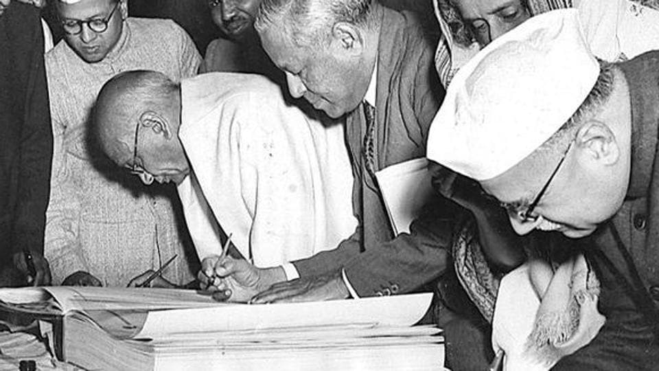 Key members of the Constituent Assembly sign the first copies of the Constitution in this file photo.