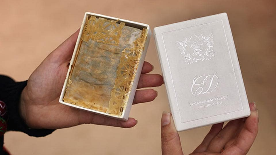 """The piece of fruitcake, housed in a special box marked on the cover, """"CD, Buckingham Palace, 29th July 1981,"""" is expected to fetch USD 800"""