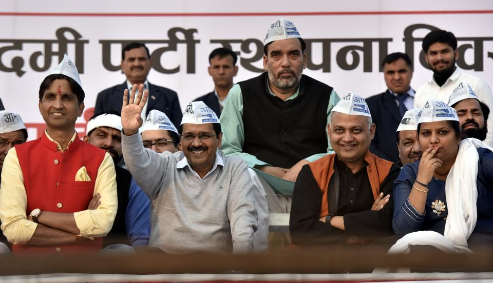 AAP chief and Delhi chief minister Arvind Kejriwal with party leaders at Ram Lila Maidan in New Delhi on Sunday.