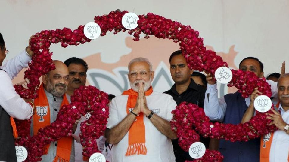 "Prime Minister Narendra Modi and BJP President Amit Shah being garlanded during ""Gujarat Gaurav Mahasammelan"" in Ahmedabad."