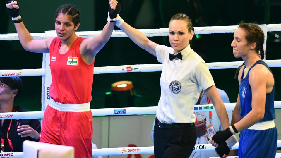 India's Sakshi (L) is declared the winner against Ivy-Jane Smith of England following the final bout of the bantam weight (54kg) category at the AIBA Women's World Youth Boxing Championships in Guwahati on Sunday.