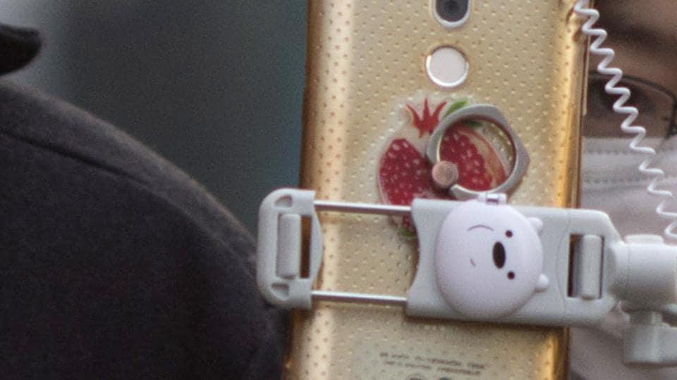 selfie stick,mobile filming,couple
