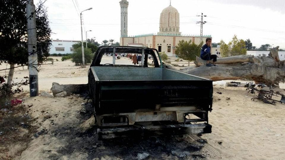 A burned truck is seen outside Al-Rawda Mosque in Bir al-Abd northern Sinai, Egypt a day after attackers killed hundreds of worshippers, on Saturday, Nov. 25, 2017.