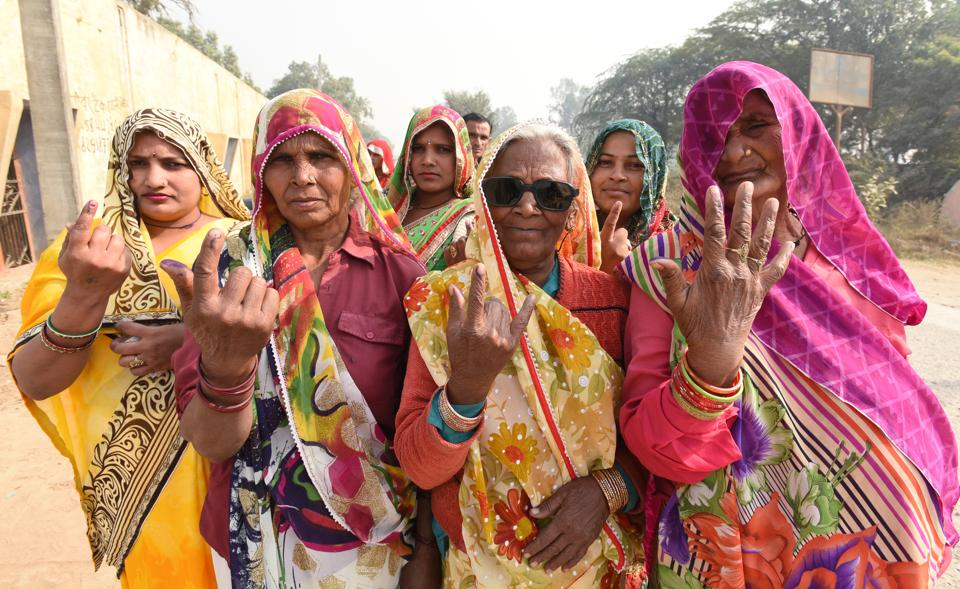 Women of Rabupura show their inked fingers after casting their votes on Sunday.