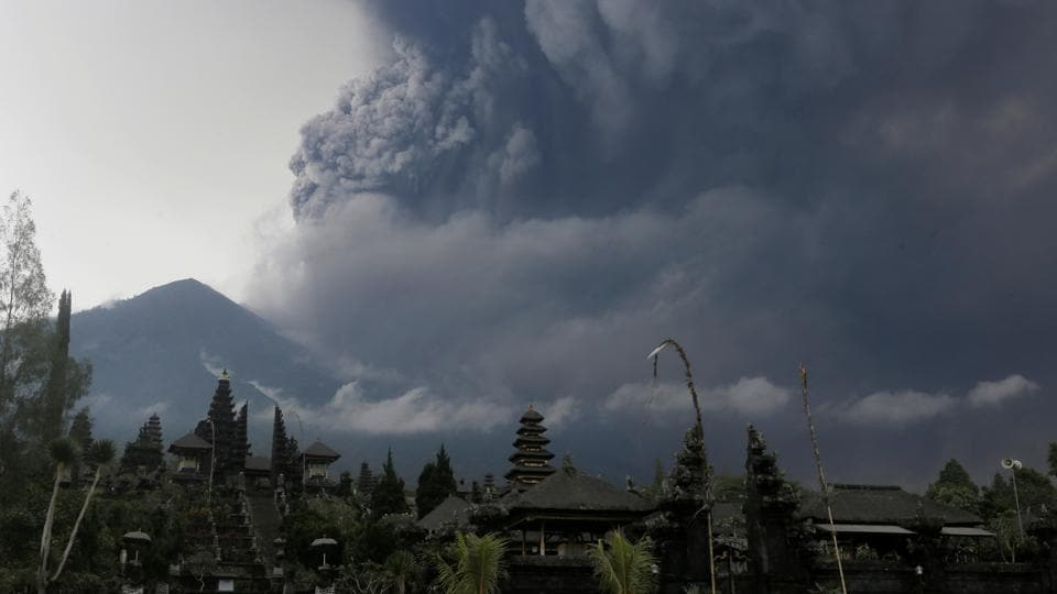 Foreign tourists take pictures as Mount Agung erupts at Besakih Temple in Karangasem, Bali, Indonesia on November 26, 2017.