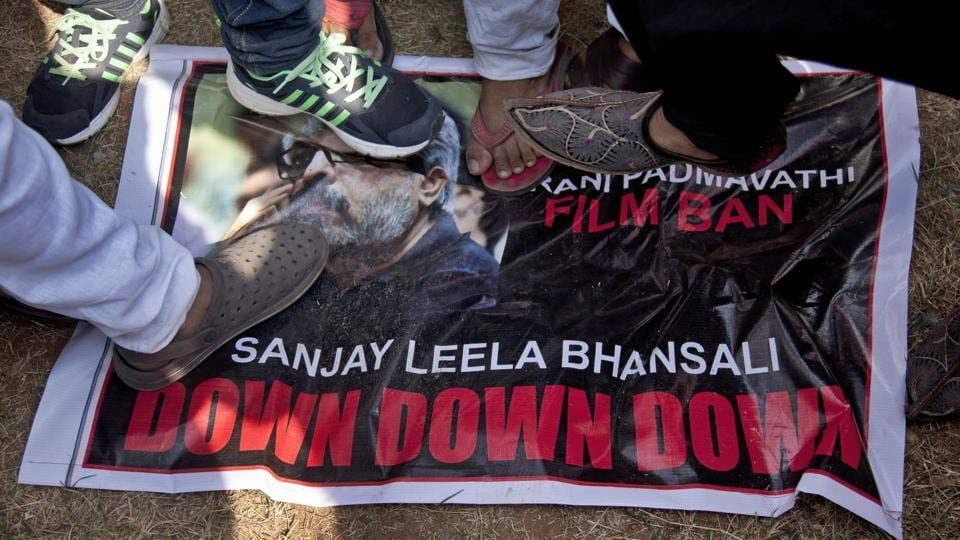 Members of Rajput community stamp on a poster of film director Sanjay Leela Bansali as they protest against the release of Bollywood film
