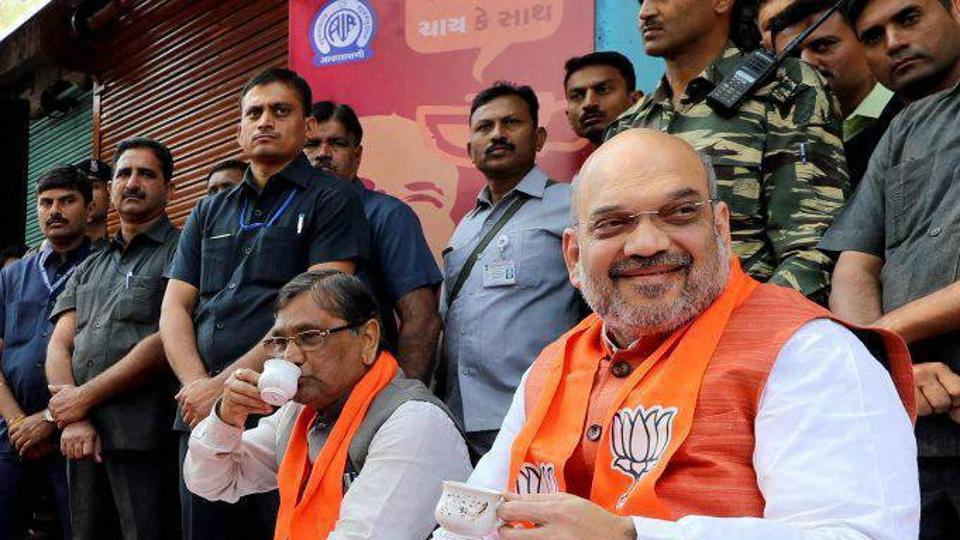 BJP chief Amit Shah listening to Prime Minster Narendra Modi's Mann Ki Baat radio programme in Ahmedabad on Sunday.