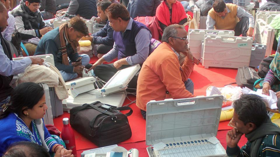 Polling officers collect electronic voting machines before leaving for polling booth in Lucknow on Saturday.