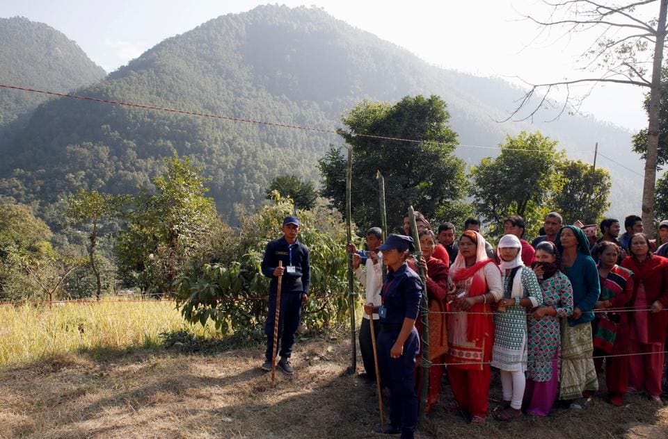 Villagers wait in a queue to cast their votes at a polling station during the parliamentary and provincial elections in Sindhupalchok District, Nepal November 26, 2017. REUTERS/Navesh Chitrakar