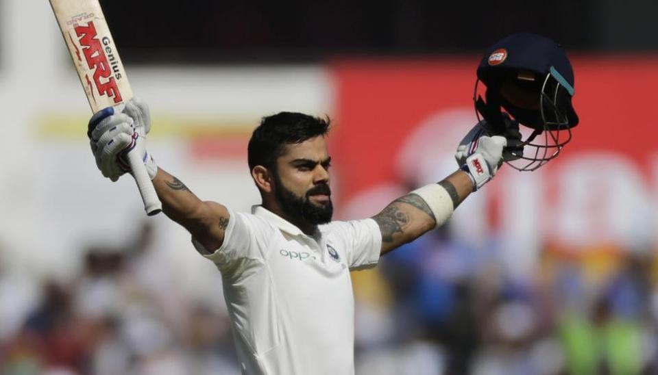 Virat Kohli celebrates after scoring a century on Day 3 of the second Test match between India and Sri Lanka at the Vidarbha Cricket Association Stadium in Nagpur.
