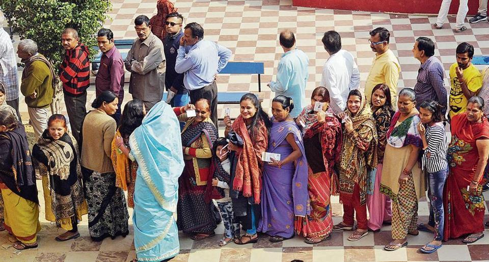 Voters queued up at a polling booth in LDA colony,Kanpur road.
