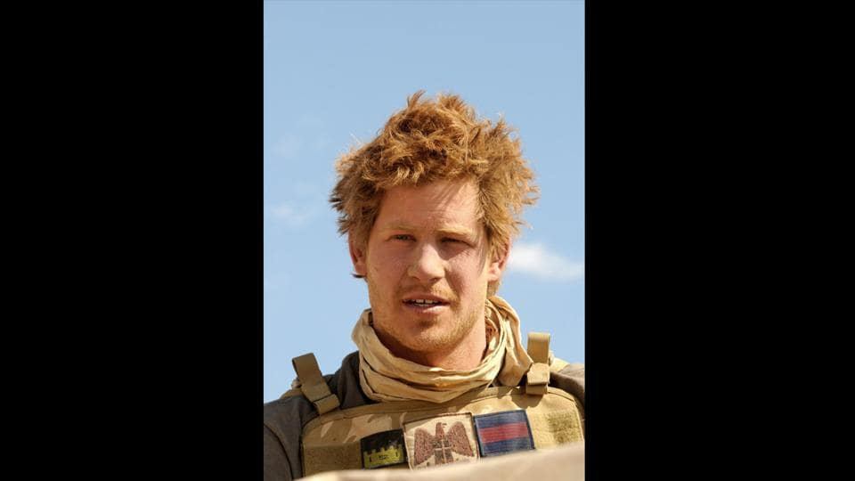 In a photo from February 2008, a young Prince Harry is pictured in the desert in Helmand province, Afghanistan. British social attitudes have transformed in recent decades but the monarchy has been bound by a more traditional values. The queen's approval of the marriage is a stark demonstration of how the monarchy has also changed in the last 80 years when the idea of a royal marrying someone who was divorced was inconceivable. (John Stillwell / AFP)