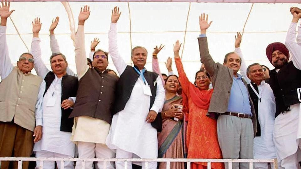 INLD leader Abhay Chautala (third from left), AIJASS president Yashpal Malik (centre) and Union minister Birender Singh (second from right) at the Jat rally in Rohtak on Sunday.
