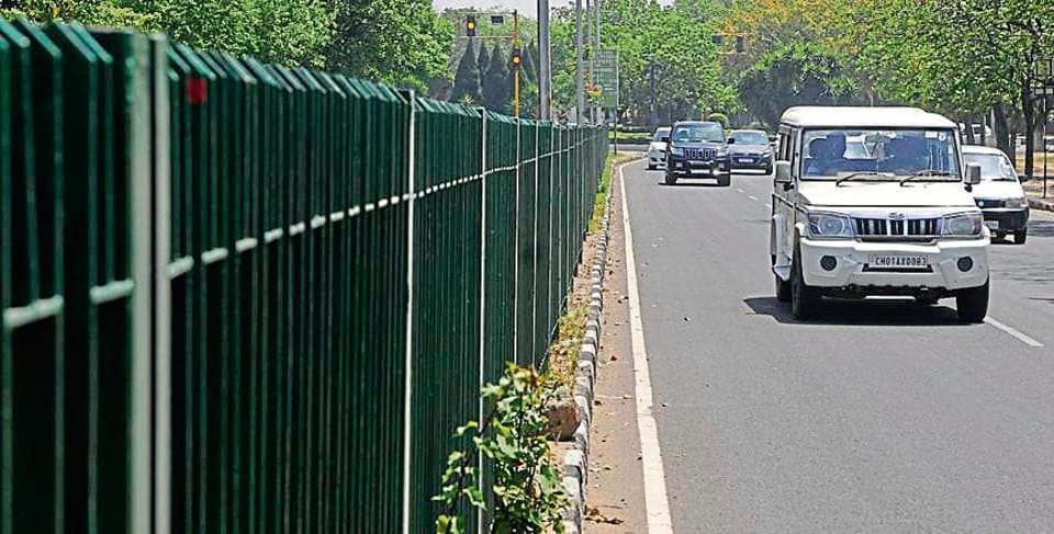 Railings installed on a median on Madhya Marg in Chandigarh. Even as the UT architect department objected to the move and stated that the height should not be more than 3 feet, the engineering department went on to install 5-foot-high railings in April this year.