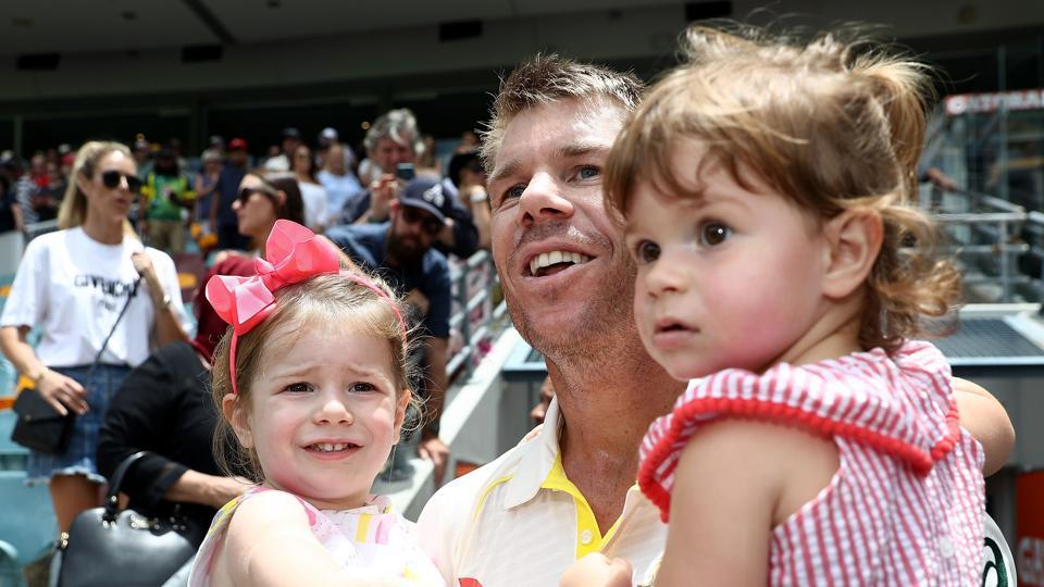 David Warner of Australia celebrates with his daughters Ivy and Indi as the team celebrated with their family members.  (Getty Images)