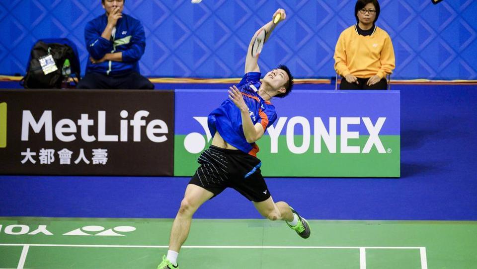 Taiwan's Tzu Wei Wang hits a shot against China's Chen Long during their quarterfinal men's singles match at the Hong Kong Open badminton tournament in Hong Kong on November 23, 2017.