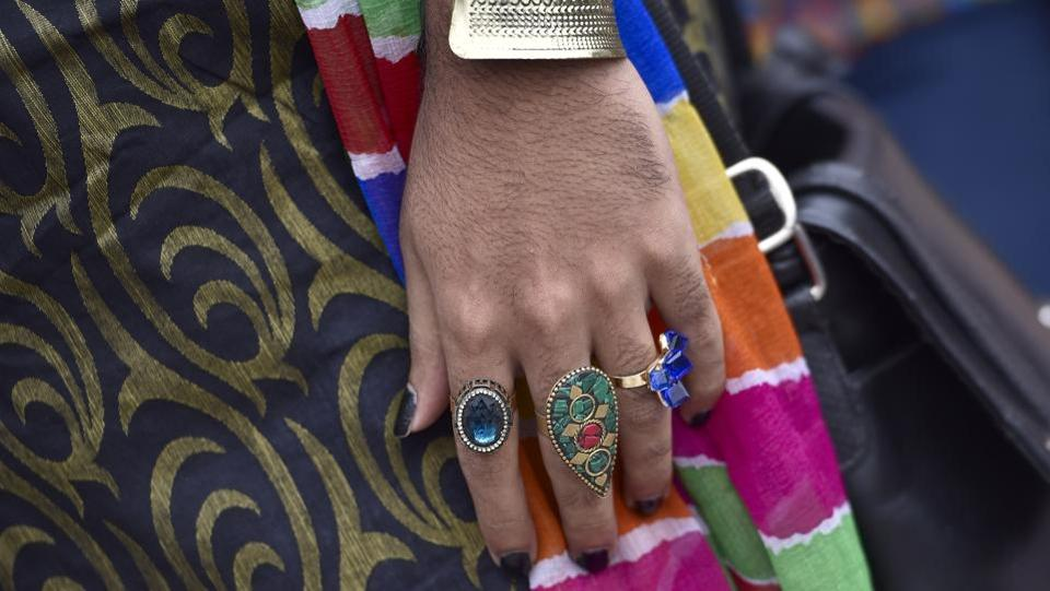 A participant flaunts finger rings during the Namma Pride and Karnataka Queer Habba celebrations in Bengaluru. Over the past decade, homosexuality has gained a degree of acceptance in India, especially in metro cities but the community continues to struggle for wider legal and societal acceptance.  (Arijit Sen / HT Photo)