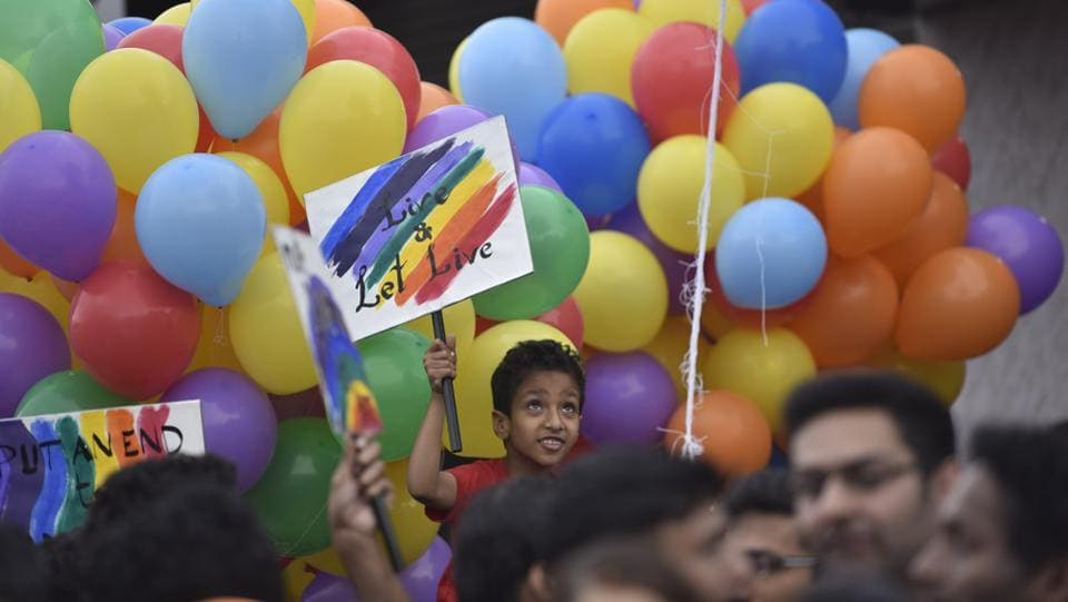A child raises a placard in support of the LGBTQI community during the pride march in Bengaluru. This year, following a Supreme Court judgment guaranteeing the Right to Privacy as a fundamental right with sexual orientation being an essential attribute, members of the community hailed the verdict and said it would boost their fight against the previous judgment. (Arijit Sen / HT Photo)