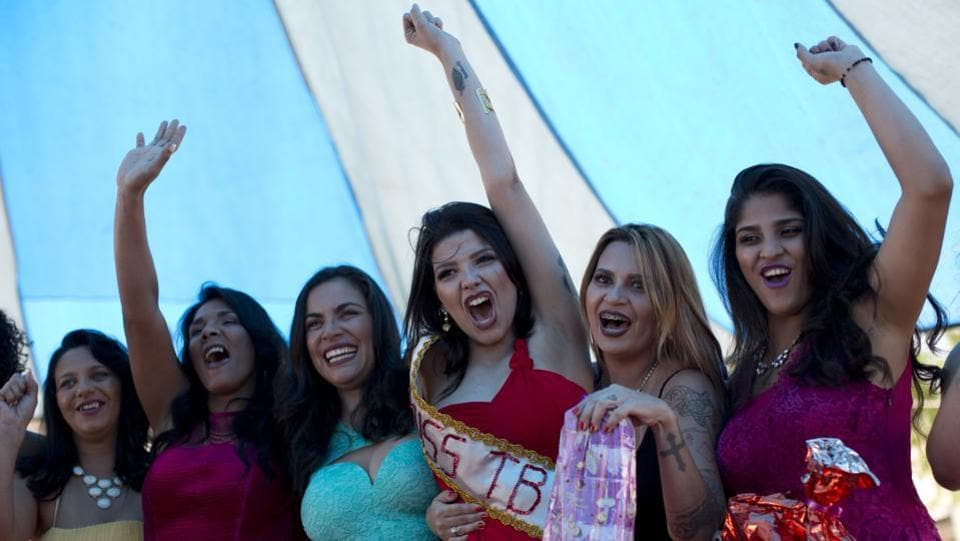 "Inmate Mayana Rosa Alves, (C) celebrates after winning the  annual beauty contest at Talavera Bruce penitentiary in Rio de Janeiro, Brazil. ""Everyone is very happy to be with their family. I just wish I had also won freedom and would have taken my sash with me out of here,"" said Alves who is serving time for robbery. The  pageant has become a tradition, where inmates for the past 12 years have competed for the ""Miss TB"" title. (Silvia Izquierdo / AP)"