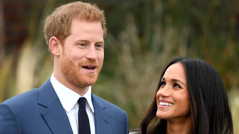 Britain's Prince Harry poses with Meghan Markle in the Sunken Garden of Kensington Palace on November 27, 2017 in London, Britain. The announcement of the duo's engagement came Monday from the office of Harry's father, Prince Charles. (Toby Melville / REUTERS)