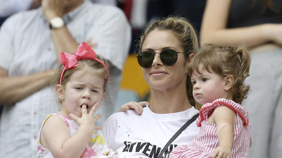 Candice Warner, the wife of Australia's David Warner, watches with their children Ivy Mae, left, and Indi Rae, as the Australian team celebrated.  (AP)