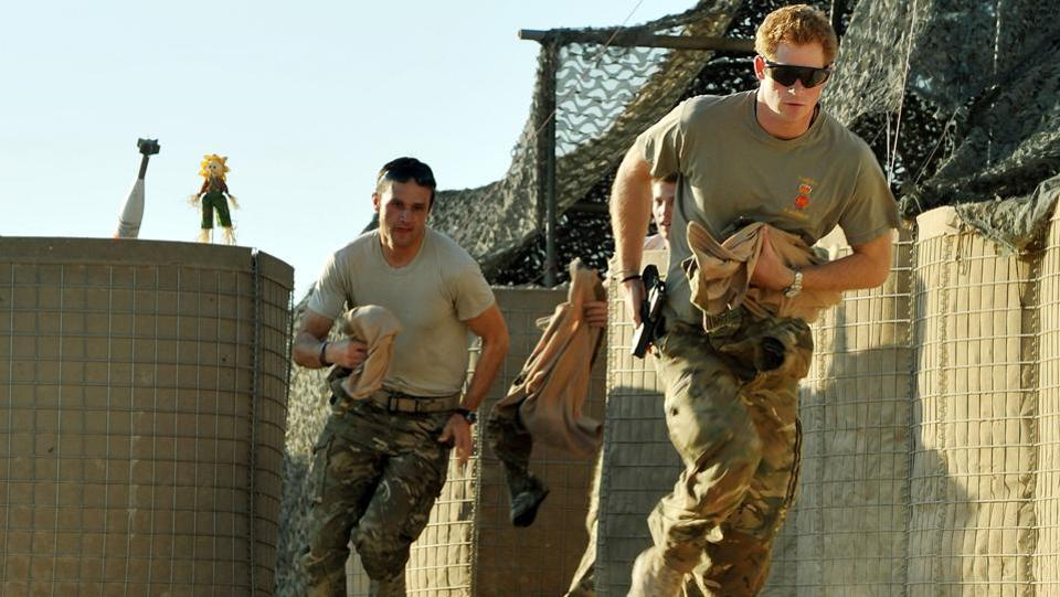 Prince Harry (R) scrambles to his Apache with a fellow pilot at the British controlled flight-line in Afghanistan in November 2012. Harry's teenage years were overshadowed by negative press headlines but he turned his around image after joining the army, where he spent 10 years. He said it was a role where he felt he could be himself without media scrutiny or the trappings of his gilded upbringing. (John Stillwell / AFP)