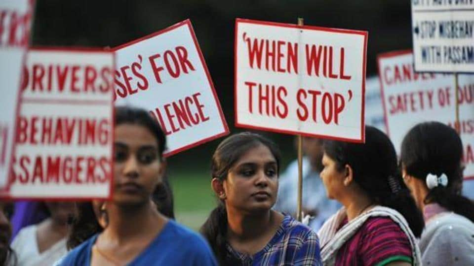 Activists holds placards as they protest against violence and crimes against women in Siliguri on July 26, 2013.