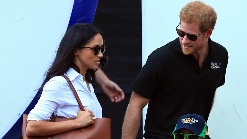 Britain's Prince Harry (R) and Meghan Markle (L) attend a Wheelchair tennis match during the Invictus Games 2017 at Nathan Philips Square on September 25, 2017 in Toronto, Canada where the duo made their first public appearance.  Like William's wife Kate, Meghan will not become a princess in her own right after marrying Harry. However, like his brother, Harry is likely to be made a duke when he marries, meaning Meghan would become a duchess. (Vaughn Ridley / AFP)