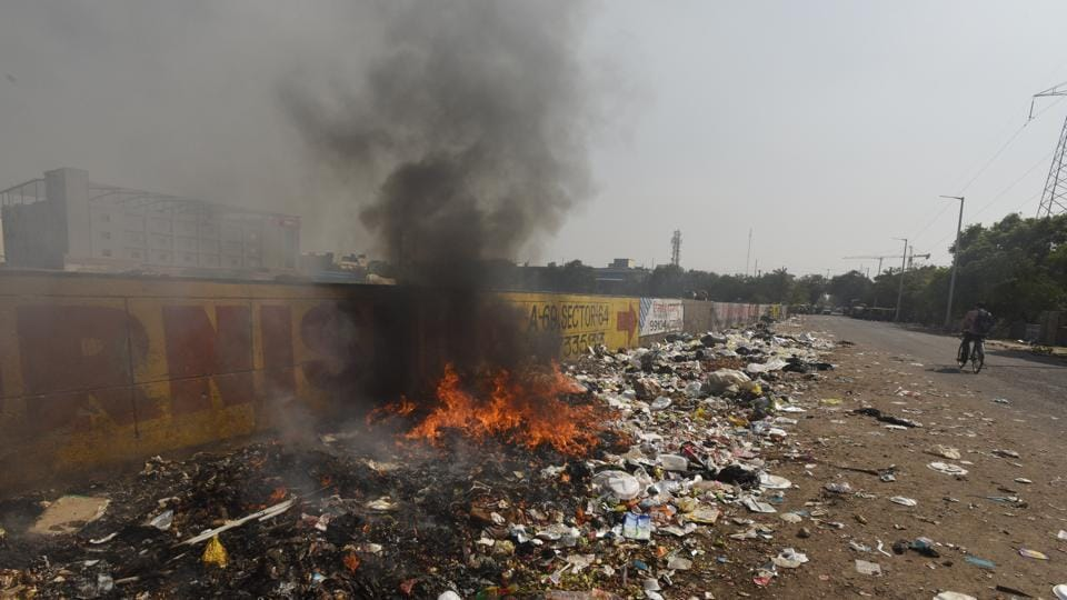Despite a ban by the NGT, burning of garbage in the open is a rampant menace in Noida.