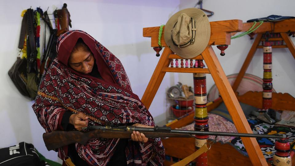 "A world away from Hollywood's red carpet, at the ancestral home she fought for in Pakistan's Sindh province, she described the night which could lead to Oscar glory. ""I will kill them or die here but never retreat,"" Dharejo, now in her late 40s, recalled saying as she checked a gun. (Asif Hassan / AFP)"