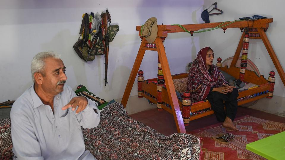 Dharejo rocked gently on a swing bed next to her husband Zulfiqar (L) in her sparse drawing room, recalling how he begged her to stand down but she refused, facing down armed relatives who had long sought to usurp her family's property. A five-year legal battle eventually saw her foes pay half a million rupees ($4,800) in compensation and offer a public apology -- an act of utmost disgrace in rural Pakistan. (Asif Hassan / AFP)