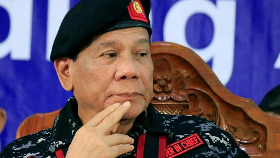 Philippine President Rodrigo Duterte, wearing a military uniform, gestures as he attends the 67th founding anniversary of the First Scout Ranger regiment in San Miguel town, Bulacan province, north of Manila, Philippines November 24, 2017.