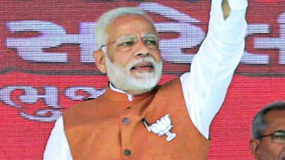 Prime minister Narendra Modi waves at the crowd during a public meeting in support of BJP candidates for assembly polls, in Bhuj on Monday.