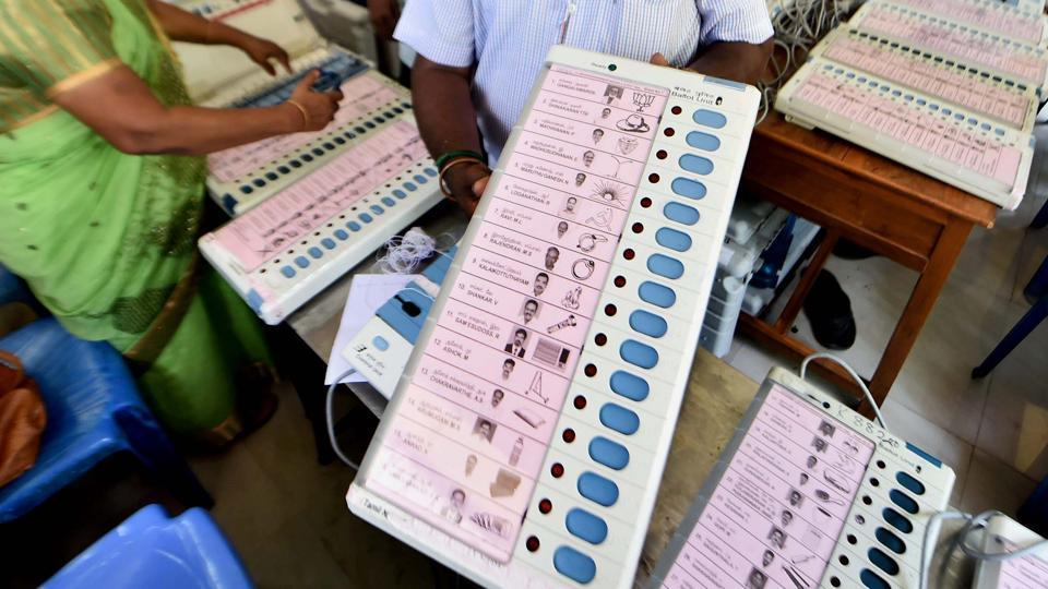 Workers readying the EVMs for R K Nagar constituency bypolls, in Chennai.