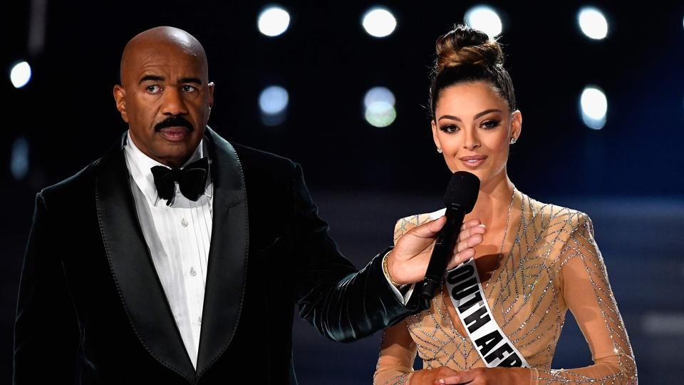 Television personality and host Steve Harvey (L) onstage with Miss South Africa 2017 Demi-Leigh Nel-Peters as she answers a question during the interview portion of the 2017 Miss Universe Pageant at The Axis at Planet Hollywood Resort & Casino on November 26, 2017 in Las Vegas, Nevada. F