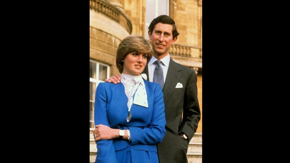 In an old photograph from February 24, 1981, Prince Harry's parents, Prince Charles and Lady Diana Spencer pose together at Buckingham Palace, following the announcement of their engagement.   (Ron Bell / AP)