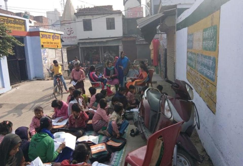 Locals were surprised to see teachers taking classes on the road in front of the school and soon the news spread.