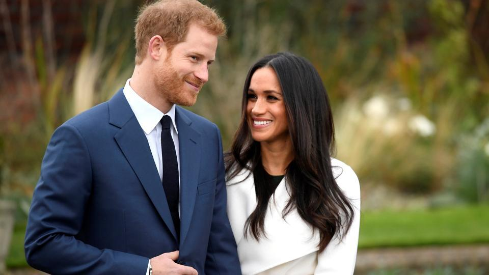 Britain's Prince Harry poses with Meghan Markle in the Sunken Garden of Kensington, after making their engagement public.