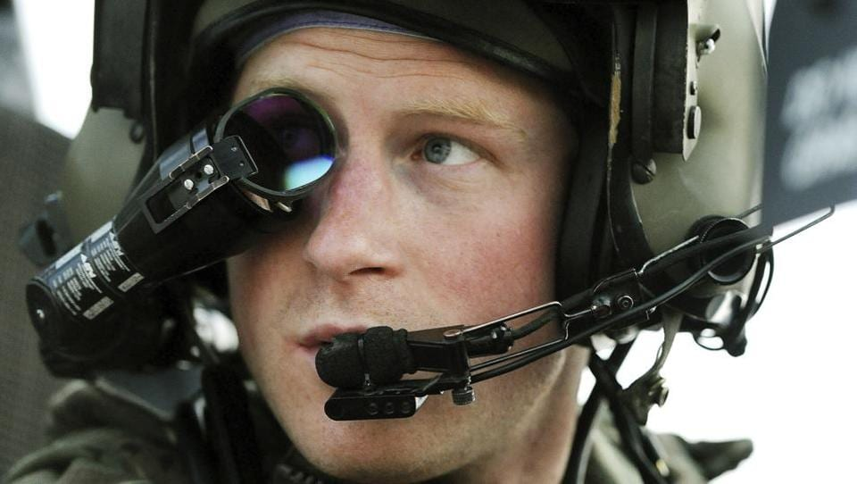 Britain's Prince Harry or just Captain Wales as he is known in the British Army, wears a monocle gun sight as he sits in his cockpit at the British controlled flight-line in Camp Bastion, Afghanistan on December 12, 2012. He left the army in 2015 to focus on royal duties and charity work, particularly the welfare of military veterans, and continuing his mother's work helping those with AIDS, and mental health issues. (AP)