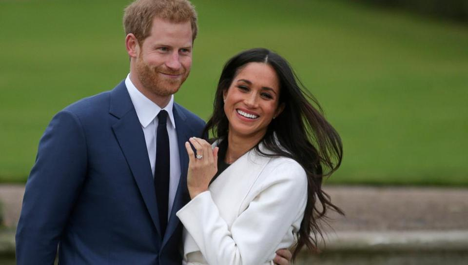 Britain's Prince Harry with his fiancée US actress Meghan Markle in the Sunken Garden at Kensington Palace in London on Monday.