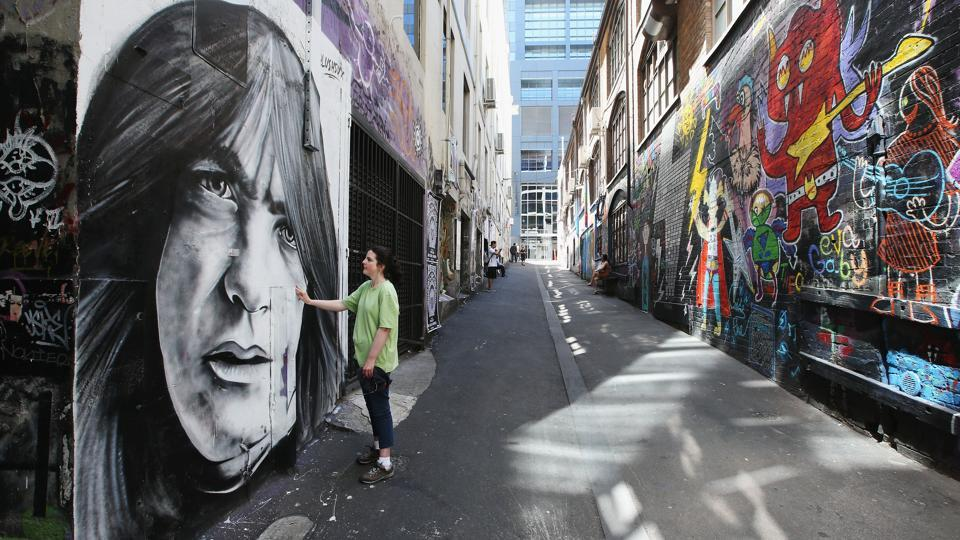 Fans pay tribute to Malcolm Young on AC/DC lane on November 28, 2017 in Melbourne, Australia. He last performed with the band in 2014, also the year in which his family confirmed that he was suffering from dementia. (Michael Dodge / Getty Images)